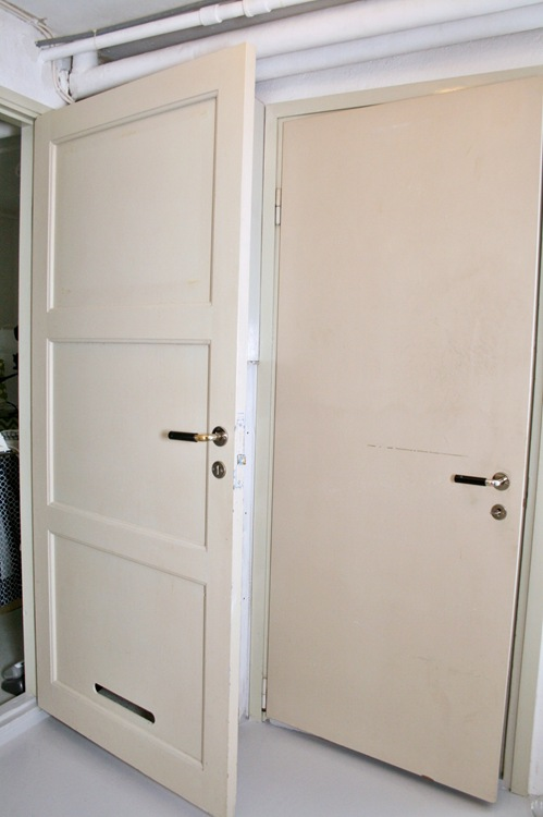 when you come down the stairs to the basement from the entry hall you're  greeted by these doors  to the left the laundry room and straight ahead my  closet